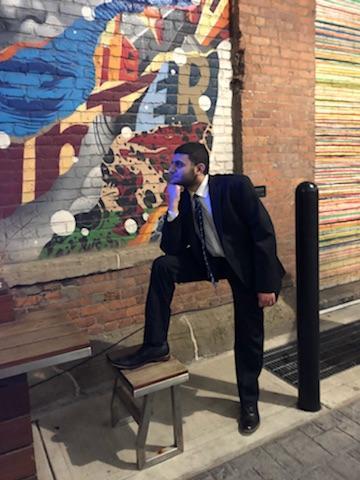 Company founder enjoying a nice mural