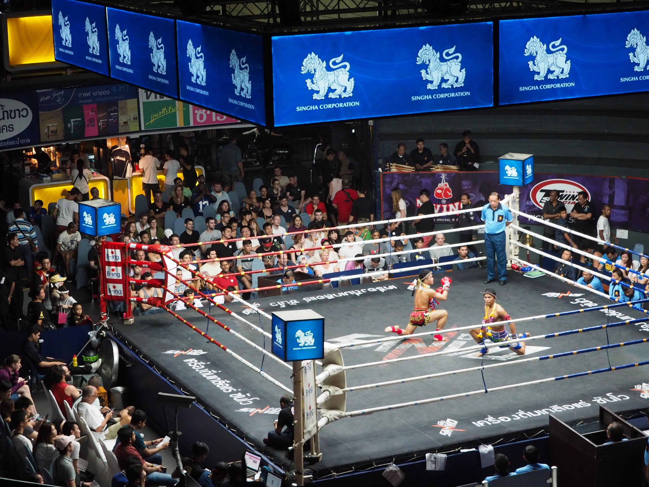 Two fighters preparing for battle, going through the wai kru ram muay ritual at the prestigious Rajadamnern stadium