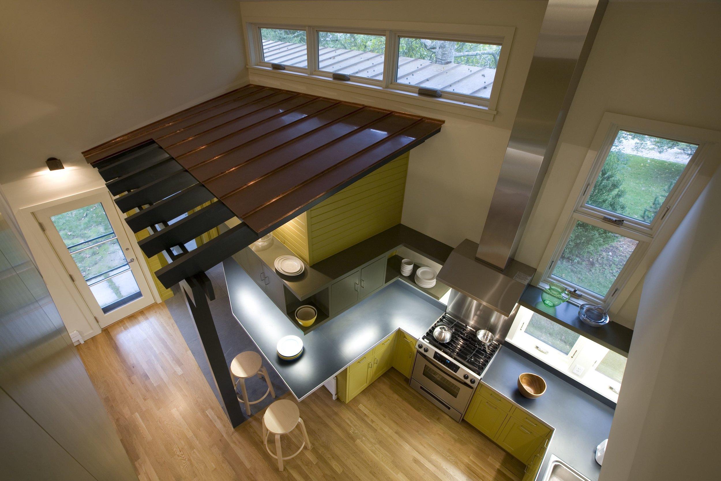 13 AVISNQ_GH_PV_INT_06 kitchen from above.jpg