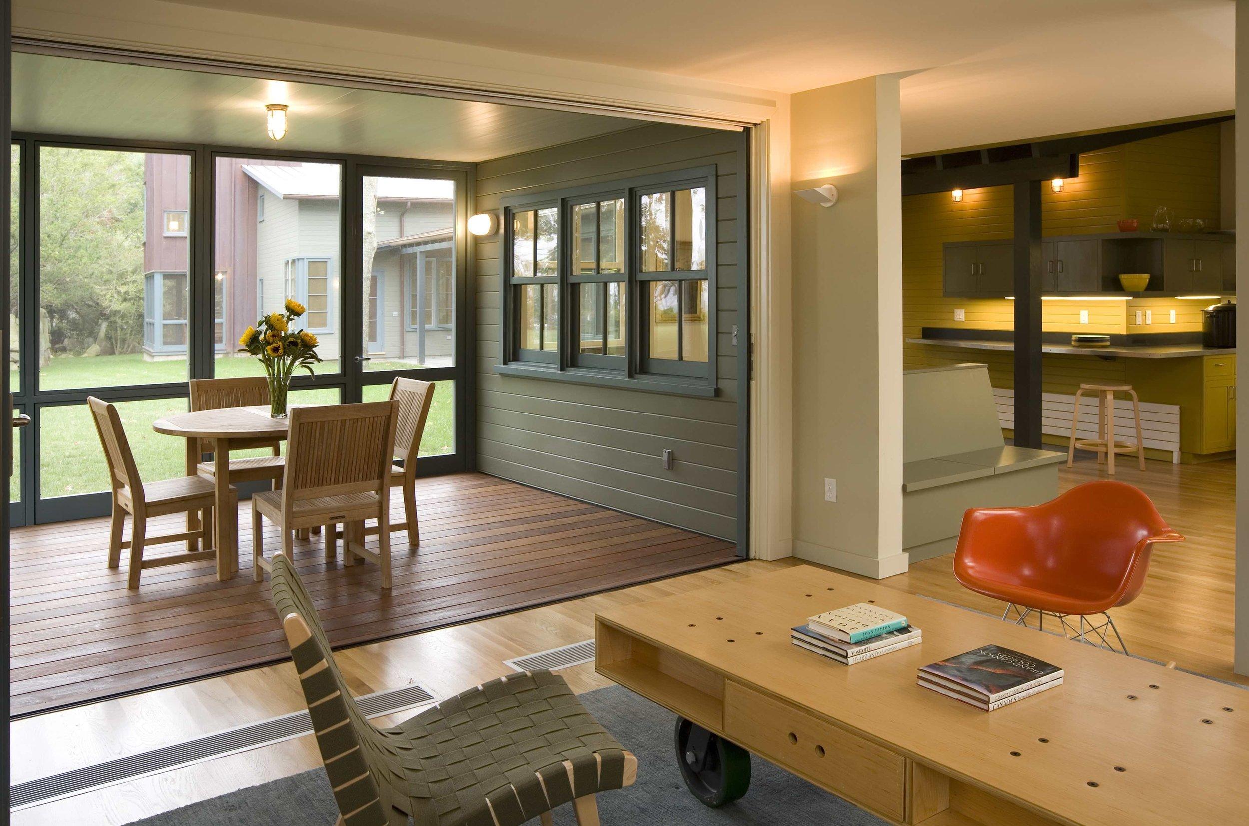 14  AVISNQ_GH_PV_INT_04 living rm + screen porch.jpg