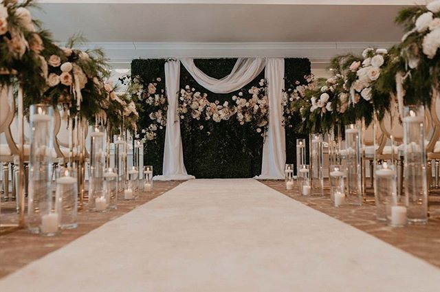 This wall from @gala.design was SO MUCH FUN to create with, a huge blank canvas . Mixed with flowers, drapping and candle light , it became the perfect ceremony backdrop. . . . . .  As always, captured perfectly by the incredible @lesmariagesdejulia  planning @mimadaevents  venue @chateauvaudreuil1989  floral design @oh.fleurs  rentals @gala.design  linens @tenuedesoiree_  cake & sweets @patisseriesanmarco  models @dulcedomodels  wedding dress @boutique J'adore tuxedo @waxmanhouse  makeup @gabbyvachonmakeup