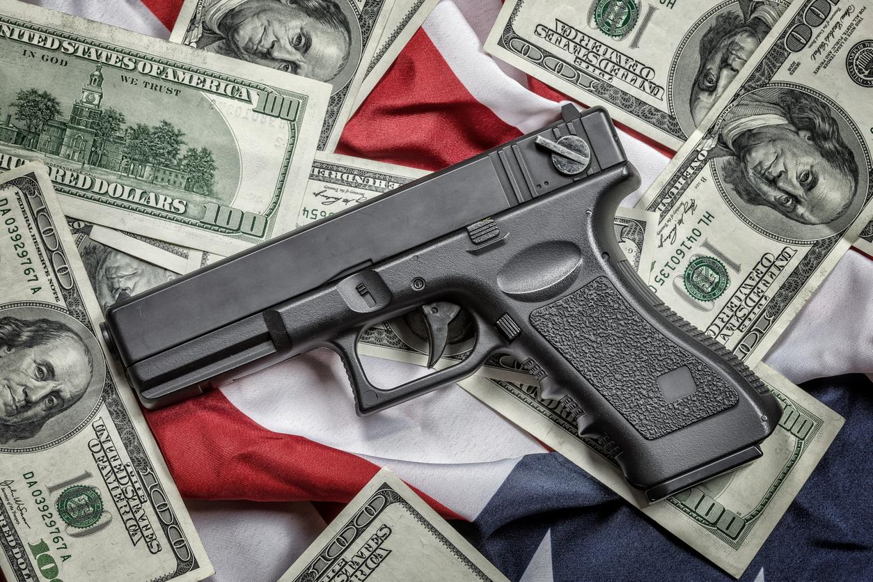 guns and money-624053696.jpg