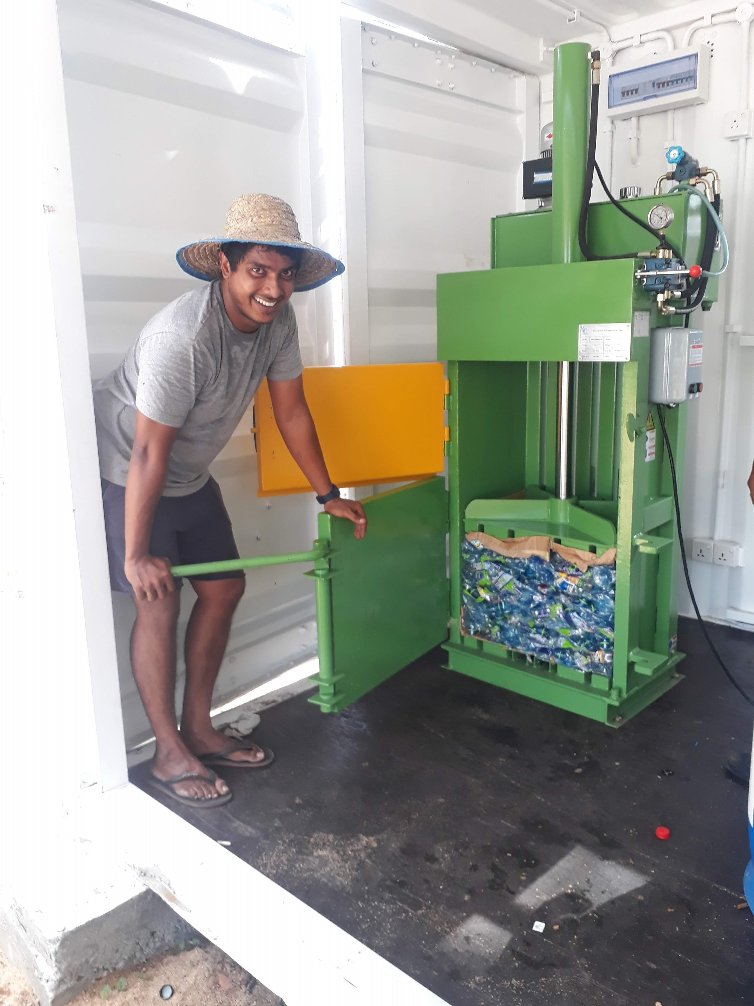 ... in this case our baling machine as tested by Co-Project Manager Fazry who worked in large scale paper recycling in Colombo for ten years. Now he is with us starting from scratch.