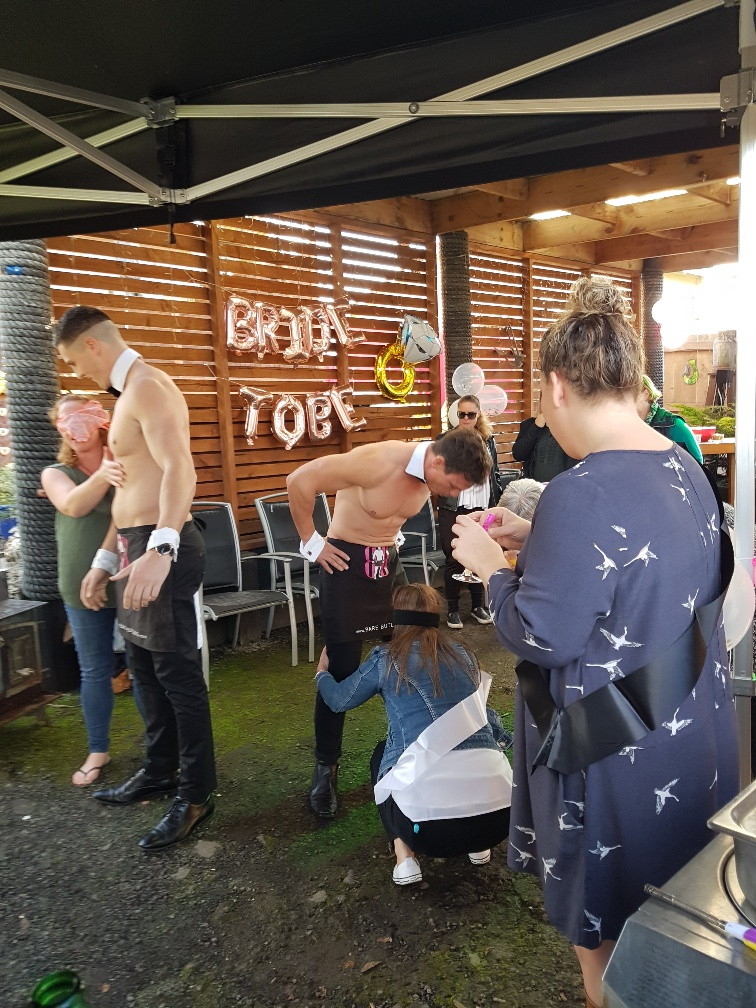 Topless waiters host Hen's party games