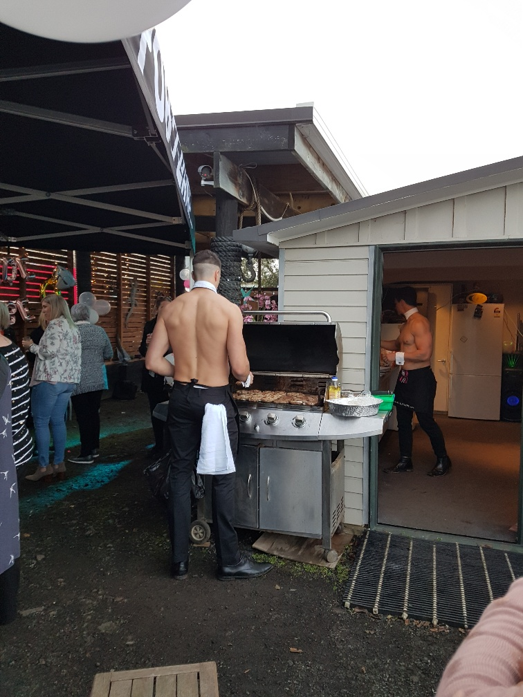 Topless waiters cook the BBQ and mix cocktails with Bare Butlers