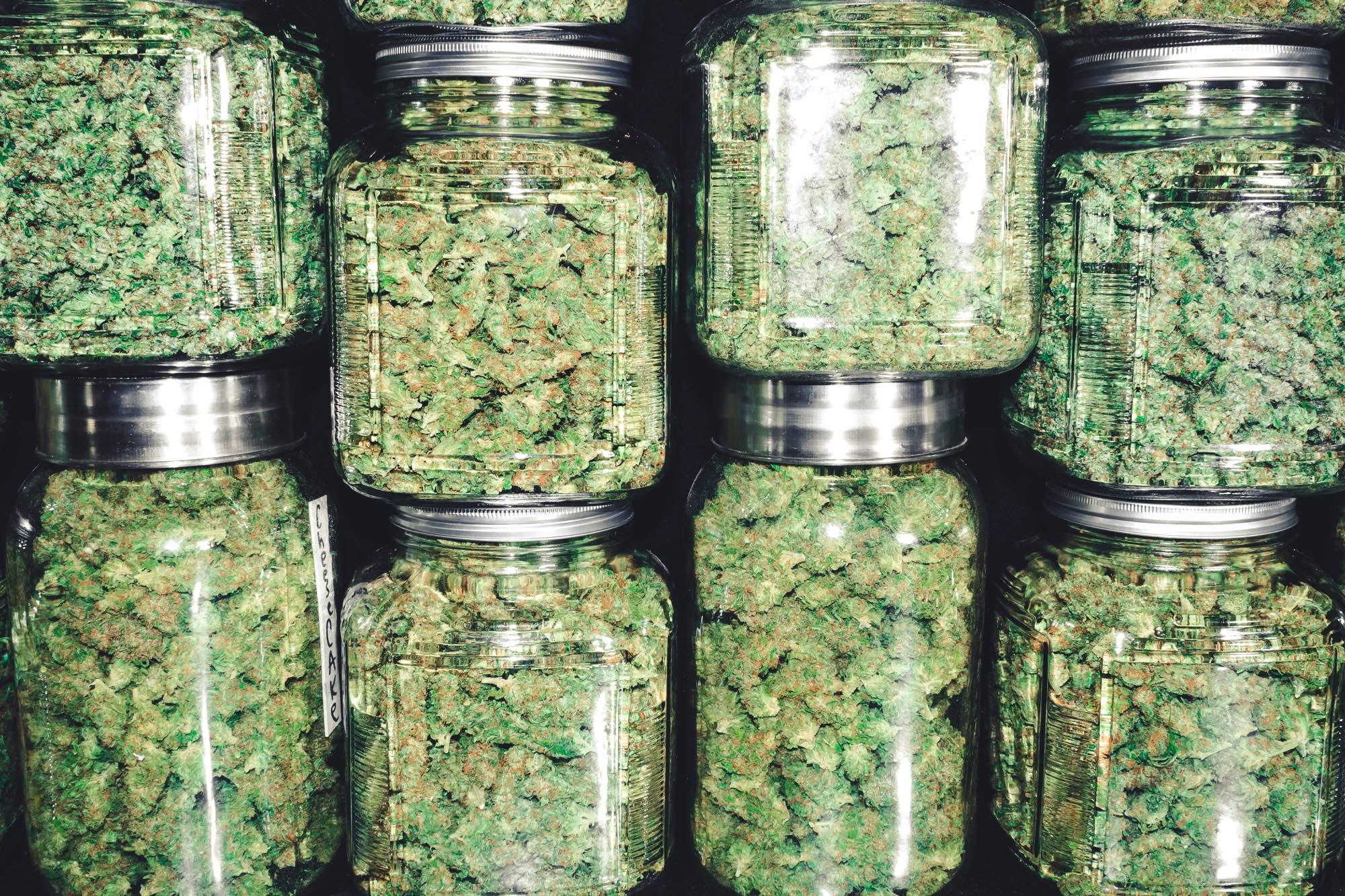 Marijuana Buds in Glass Jar Stack.jpg