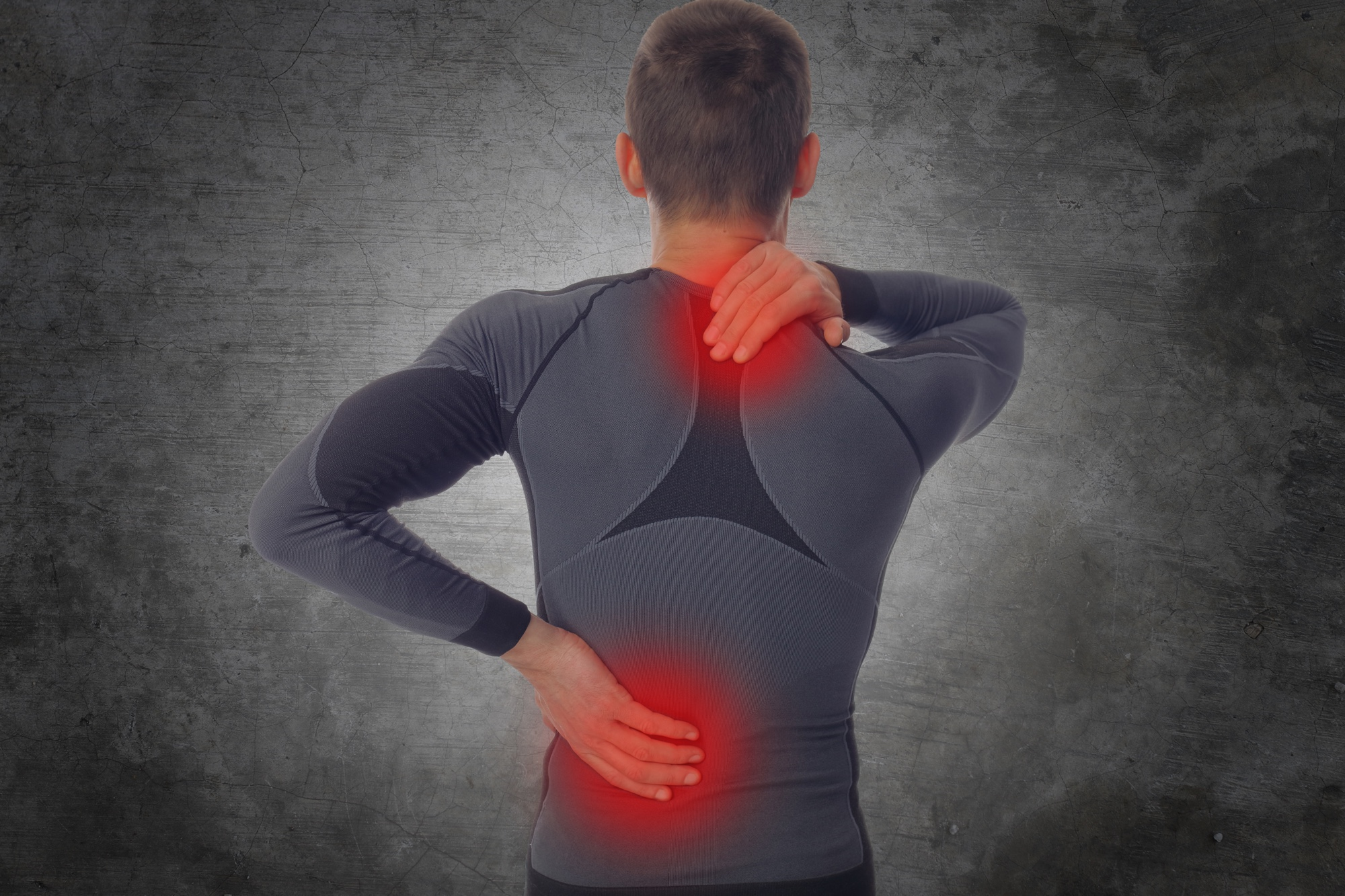 Sport injury, Man with back, neck pain. Pain relief concept..jpg