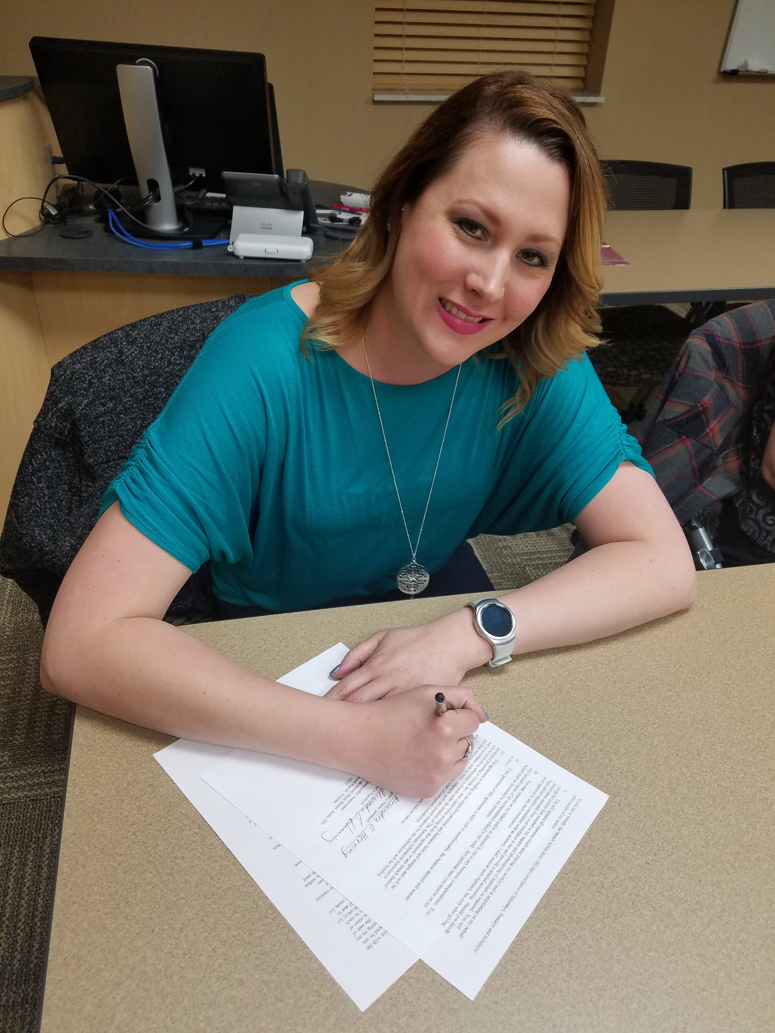 - Here's a picture of me signing my contract. Ahh!!