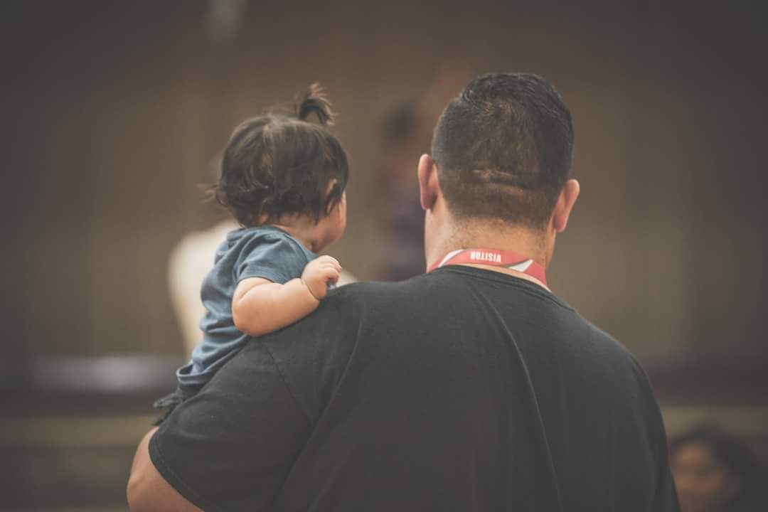 James Holding Baby.jpg