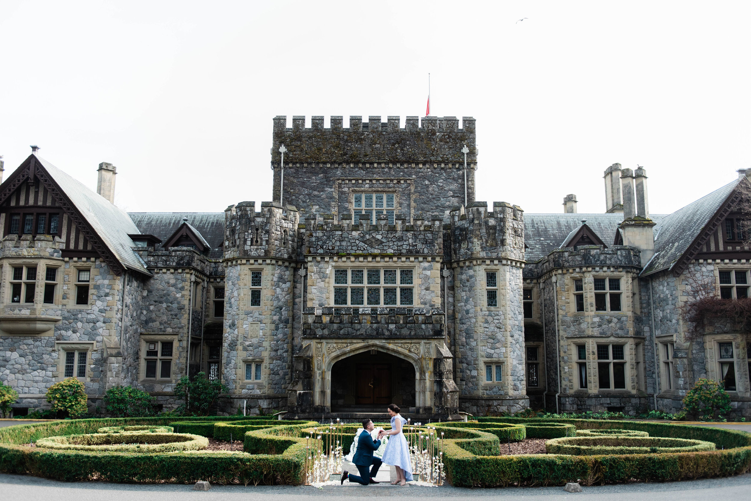 Hatley Castle Proposal  The Hatley Park estate is one of the city's most sought after marriage proposal locations! It boasts 565 oceanfront acres with amazing view of the Olympic Mountains. The estate's 650 acres is best known for its formal Italian, Rose and Japanese Gardens. Proposals are permitted on the castle grounds with 3 weeks advance notice of the requested date. (Belluxe Photography)
