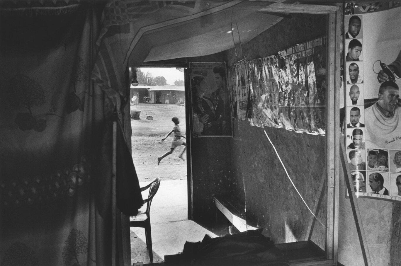 """Barbershop, Kiryandongo Refugee Settlement, Uganda"" by  Frederic de Woelmont  | Leica M6 + 35mm Lens + Ilford HP5 Film"