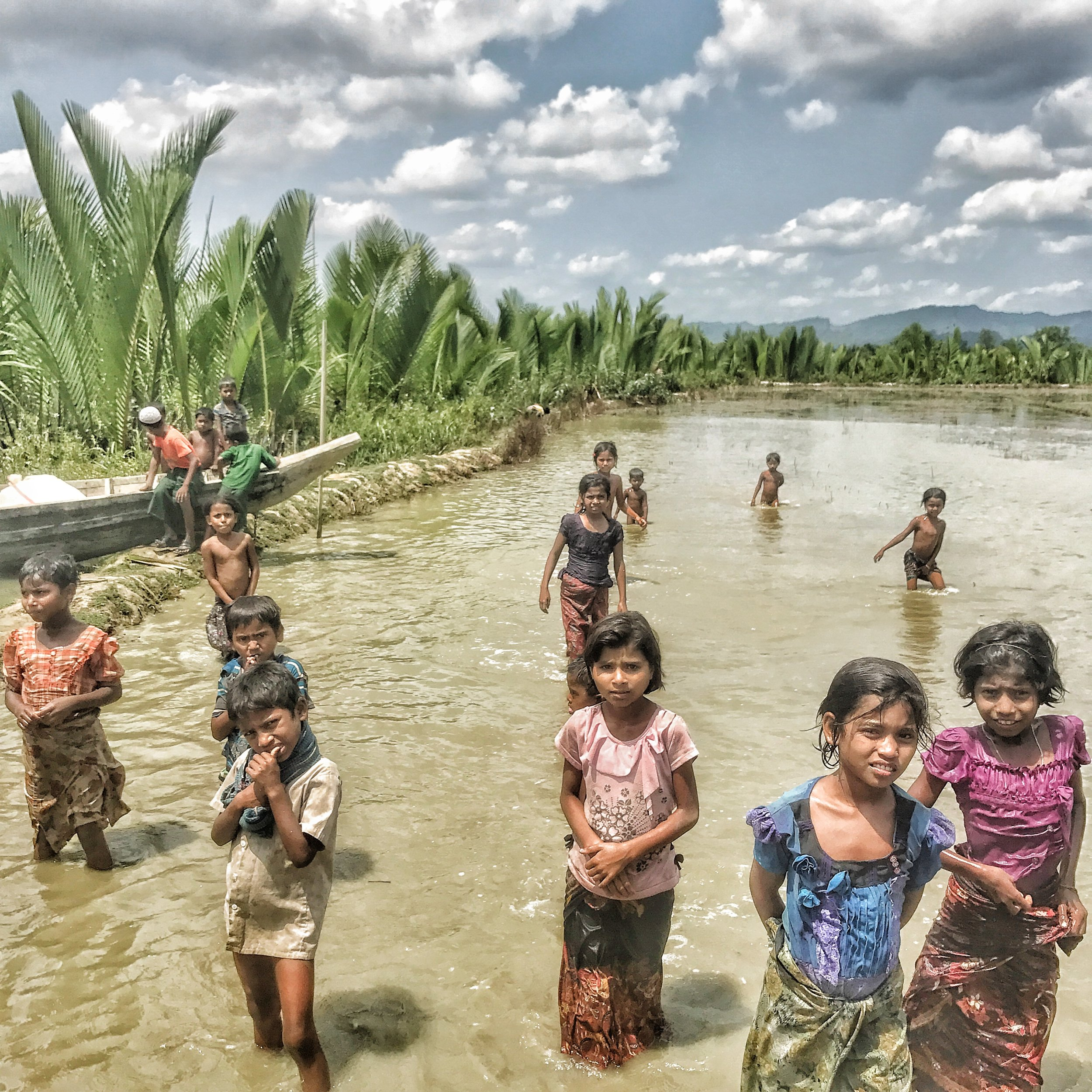 Rohingya children at play in the waters of Myanmar's Northern Rakhine State, shortly before the Rohingya Refugee Crisis.  Ashley S. Kinseth, July 2017.