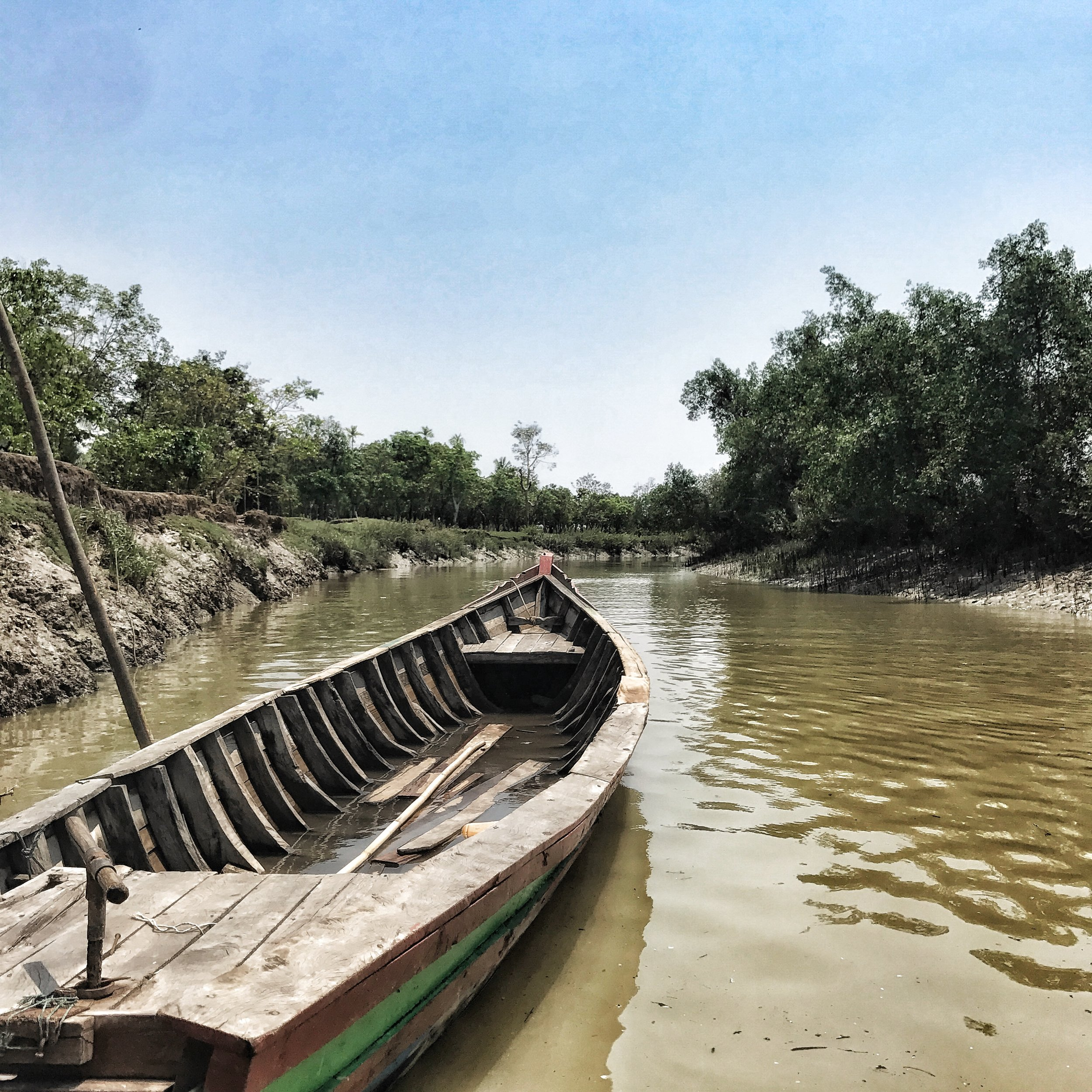 An empty boat on the riverways of seemingly-peaceful Northern Rakhine State, Myanmar, just days before the Rohingya Crisis erupted there.  Photo by Ashley S. Kinseth.