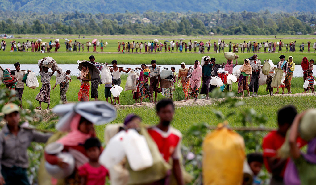 Rohingya refugees, who crossed the border from Myanmar, walk after they received permission from the Bangladeshi army to continue on to the refugee camps, in Palang Khali, near Cox's Bazar, Bangladesh. October 19, 2017. Photo by  Reuters .