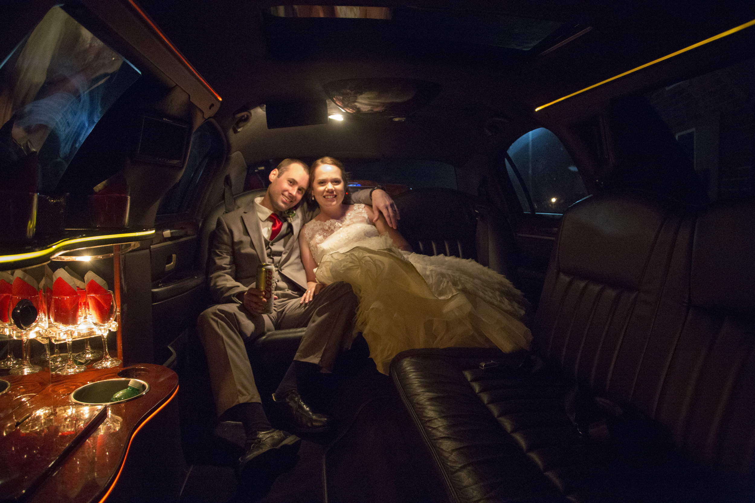 15 Inside limo with bride and groom.jpg