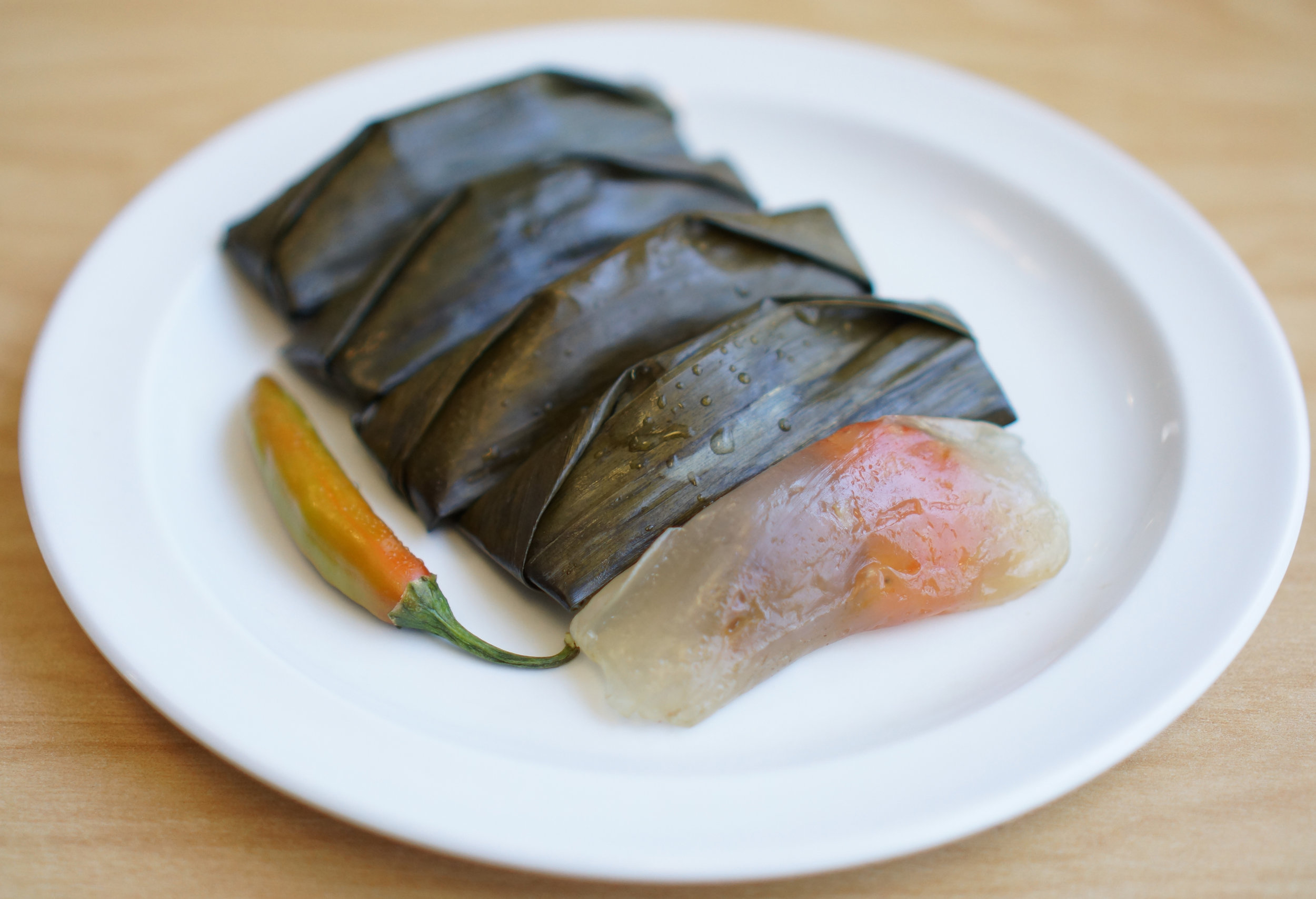Bánh Lọc - Popular appetizer in Huế. Seasoned shrimp and pork tapioca dumpling wrapped in banana leaves steamed using traditional methods