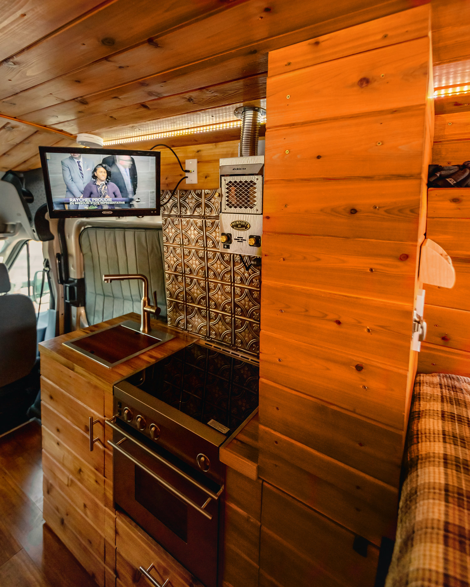 Inside the Custom Ford Camper - Tv on and the kitchen set-up