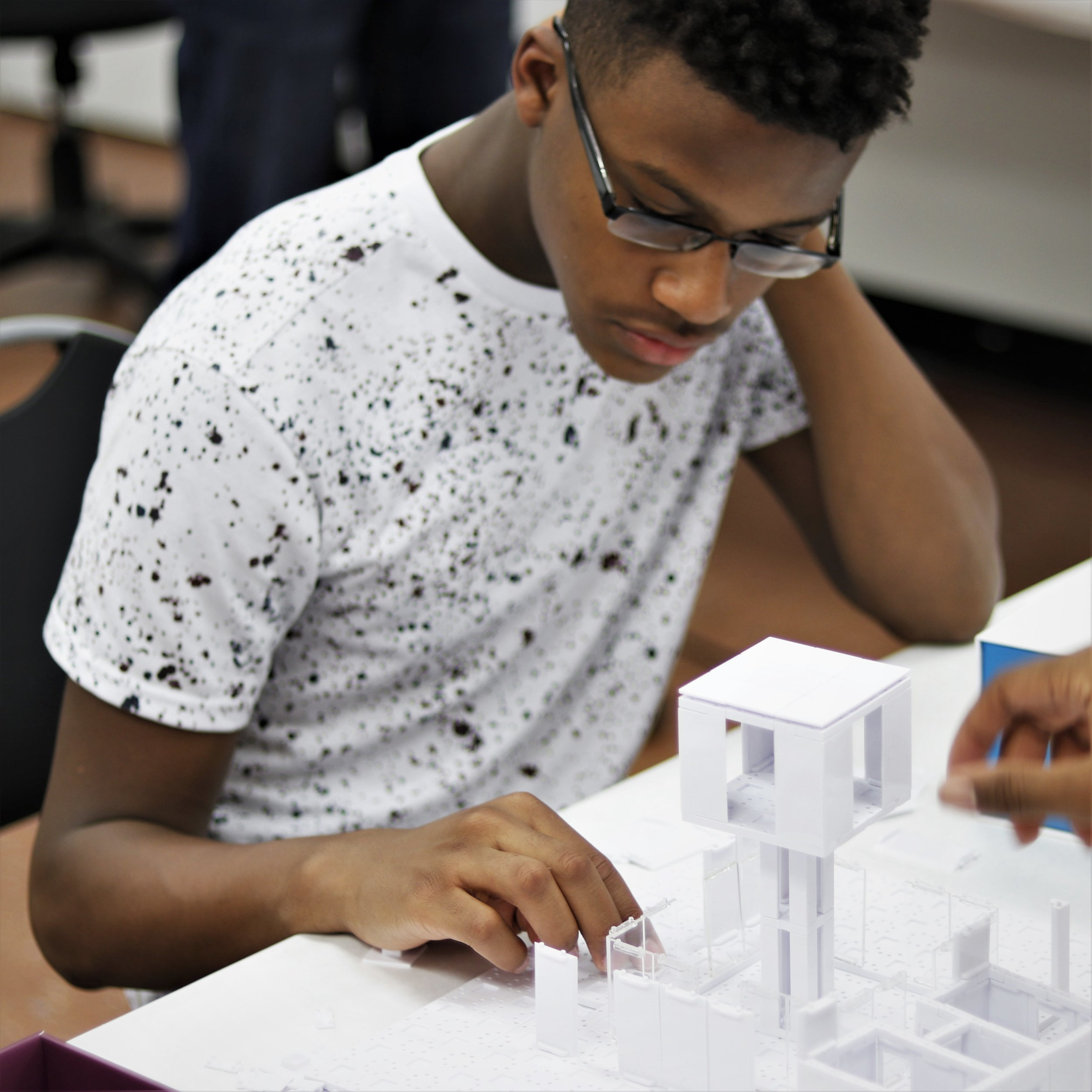 Elijah Pittman , Space and Design Intern  Elijah is a modeling enthusiast, photojournalist and aspiring architect passionate about how simple holistic design can be used as a stimulant to grow communities.