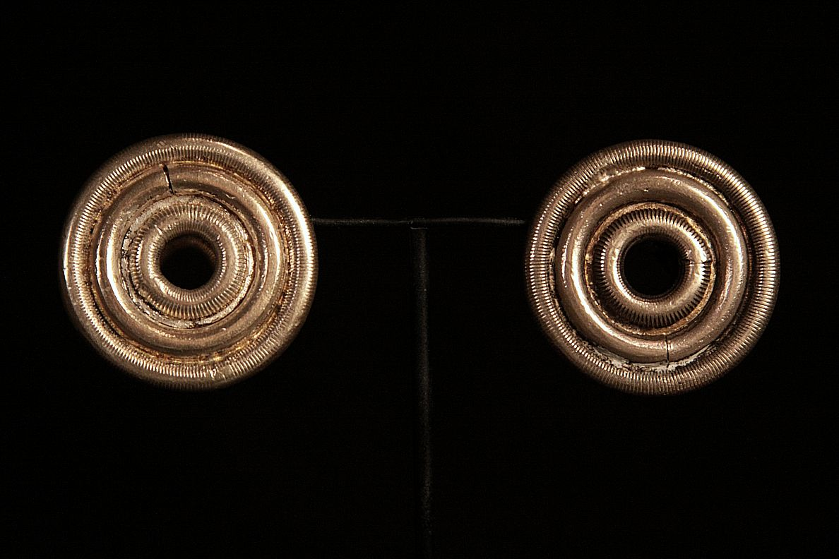 Antique Solid Ear Plug Earrings. Worn by women in Dong Tribe. Zhaoxing, China.jpg