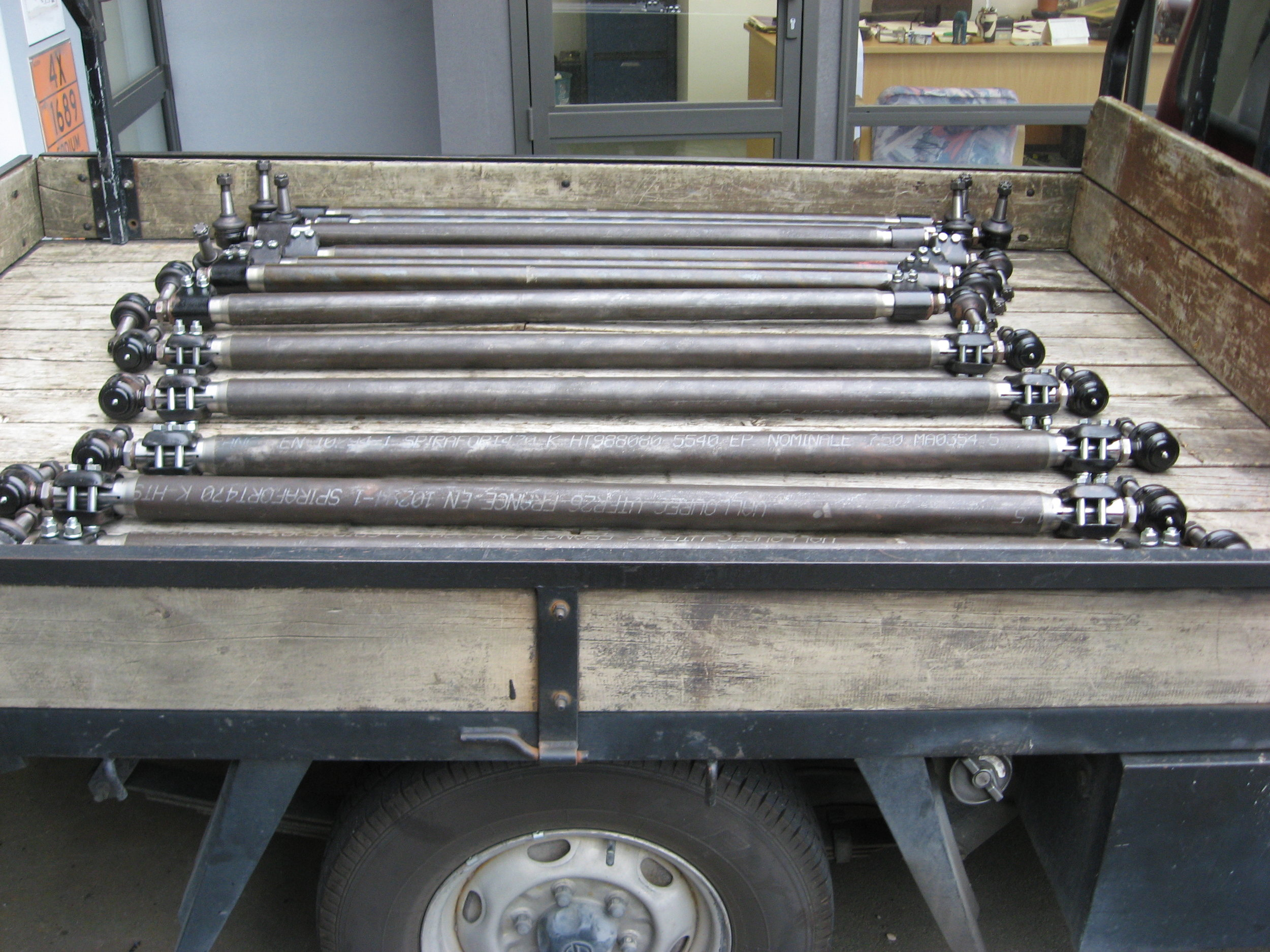 Thirteen new tie rod assemblies completed by HBI Engineering, ready for delivery.