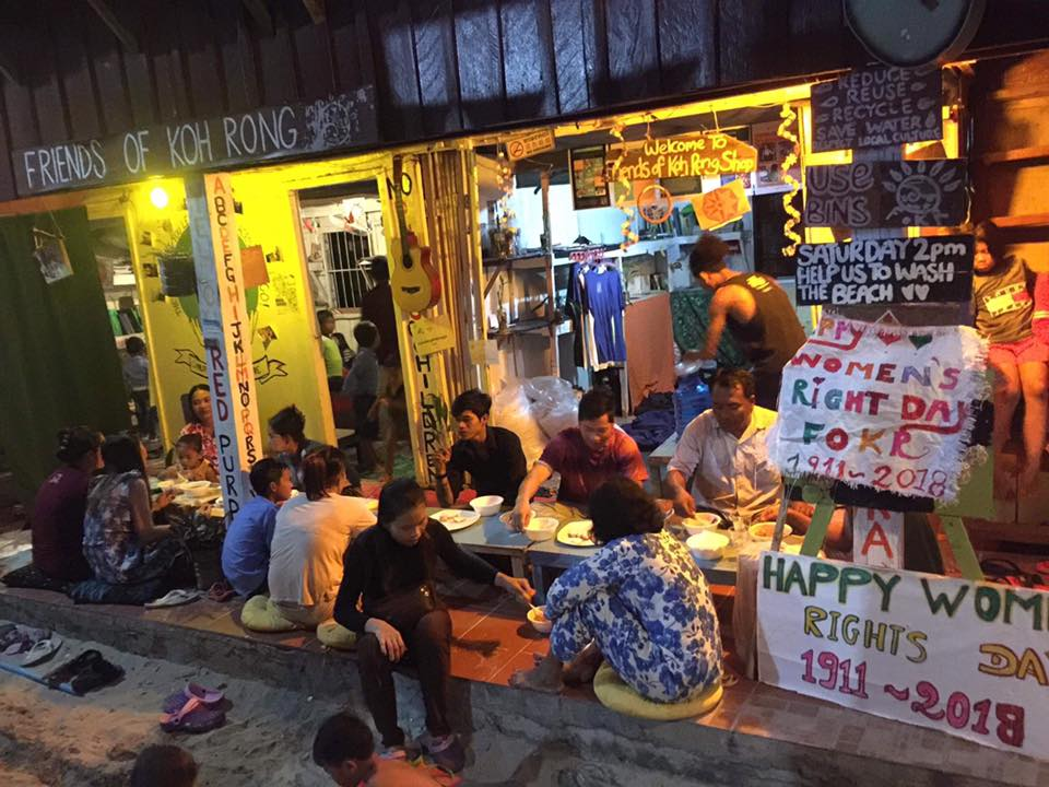 Local residents of Koh Tui village celebrate with a shared meal at the Friends of Koh Rong house.