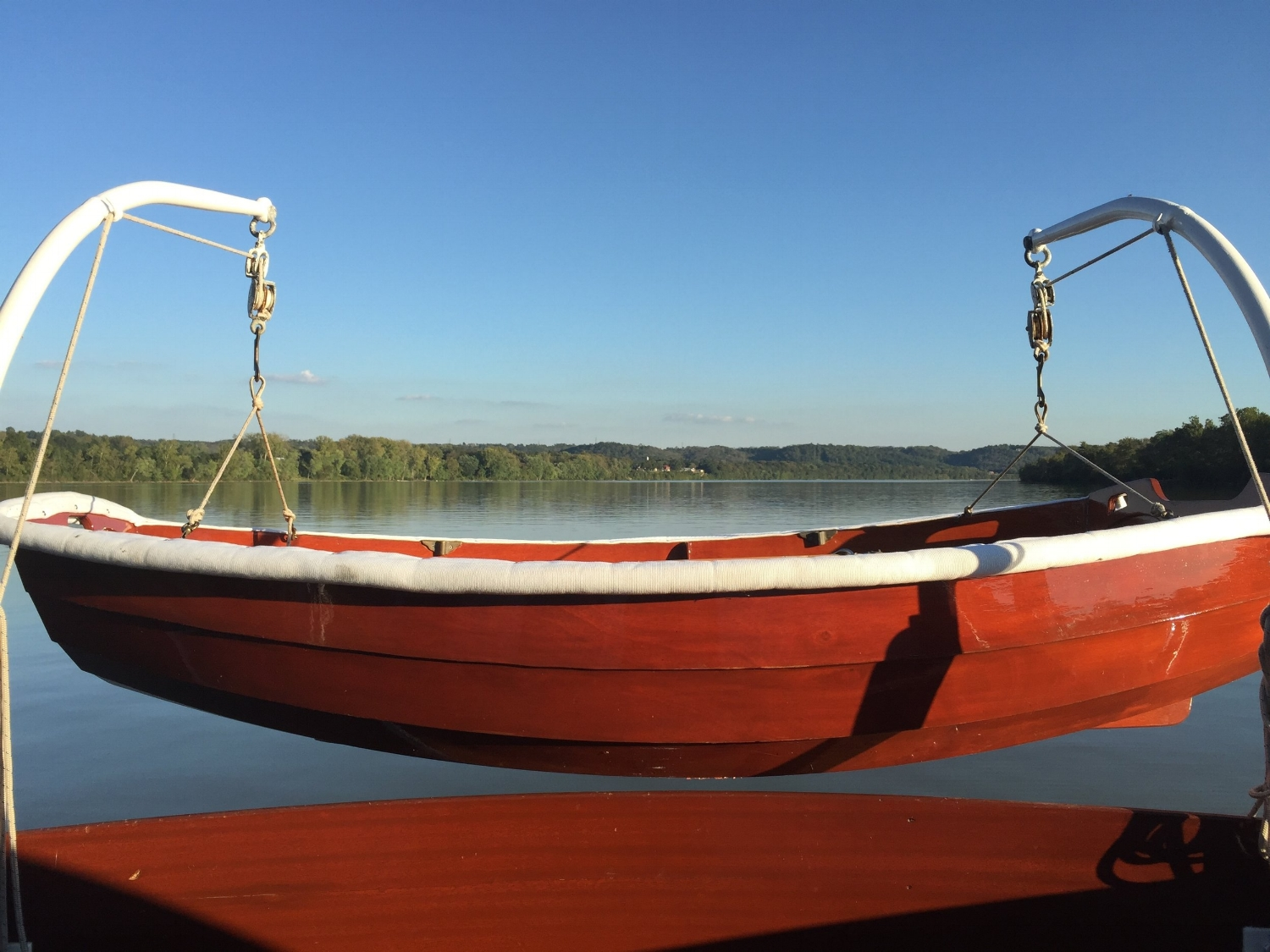Dorothy hanging off her davits on the stern. A view of the Ohio River near Aurora, Indiana.