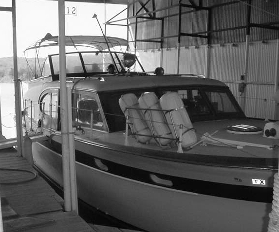 The  King and I  barely floating her slip, number 15 in boathouse ZH at Highport Marina, Lake Texoma, Pottsboro, Texas.
