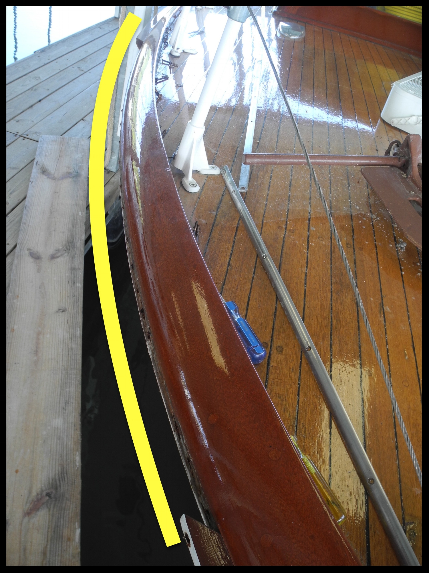 Starboard bow rail missing.