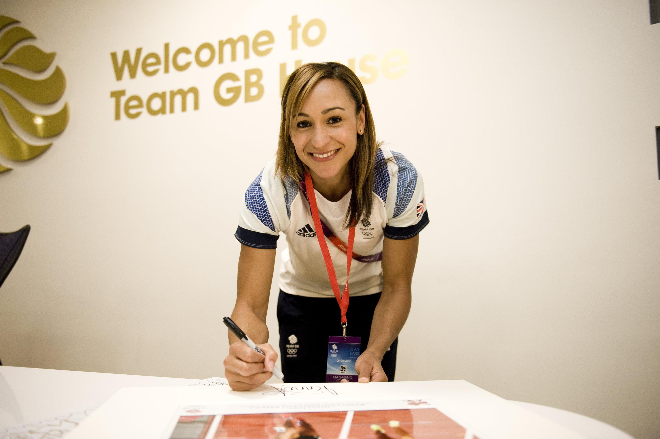 Jessica signing her photo.jpg