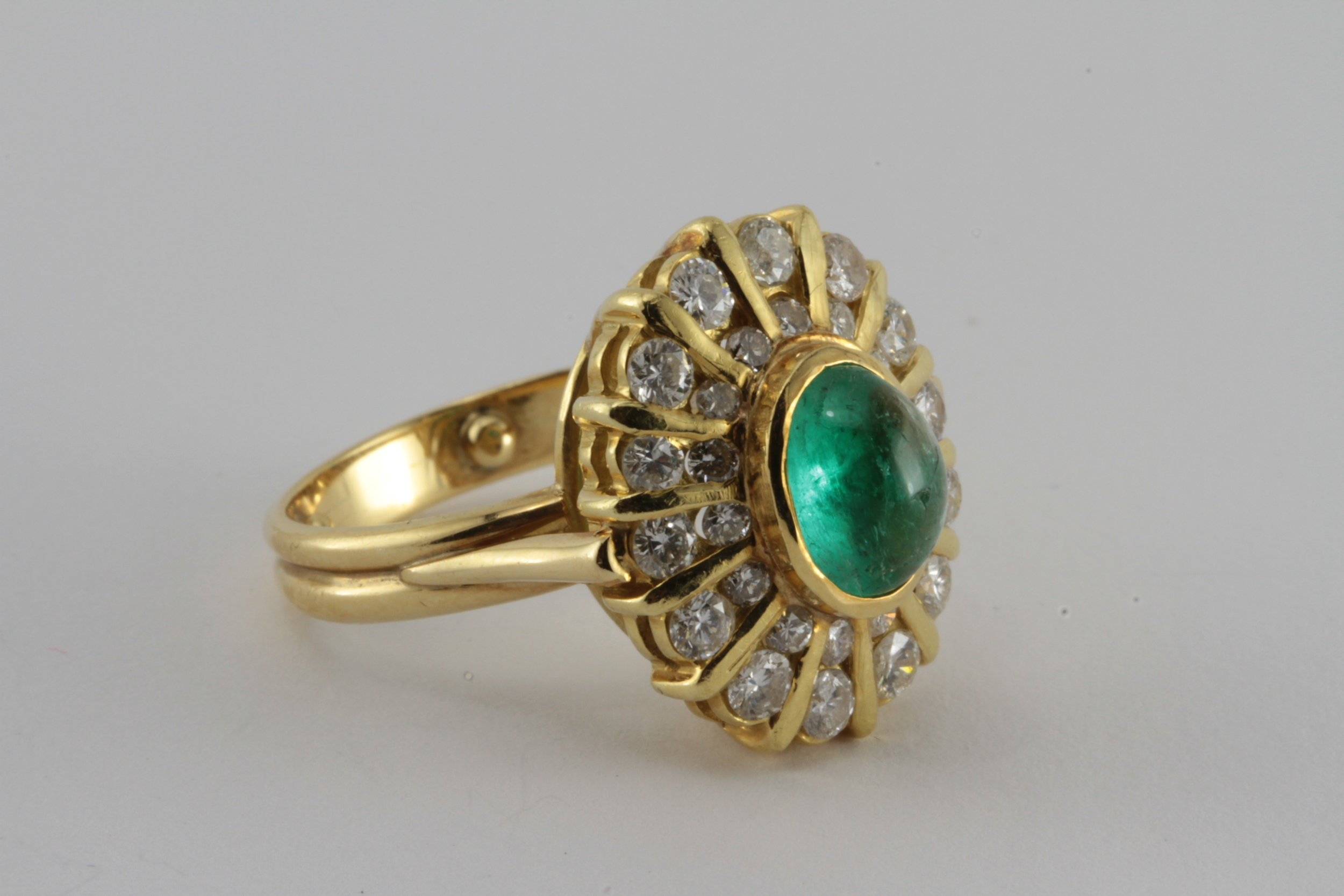 18k gold emerald and diamond ring - with over a carat of diamond