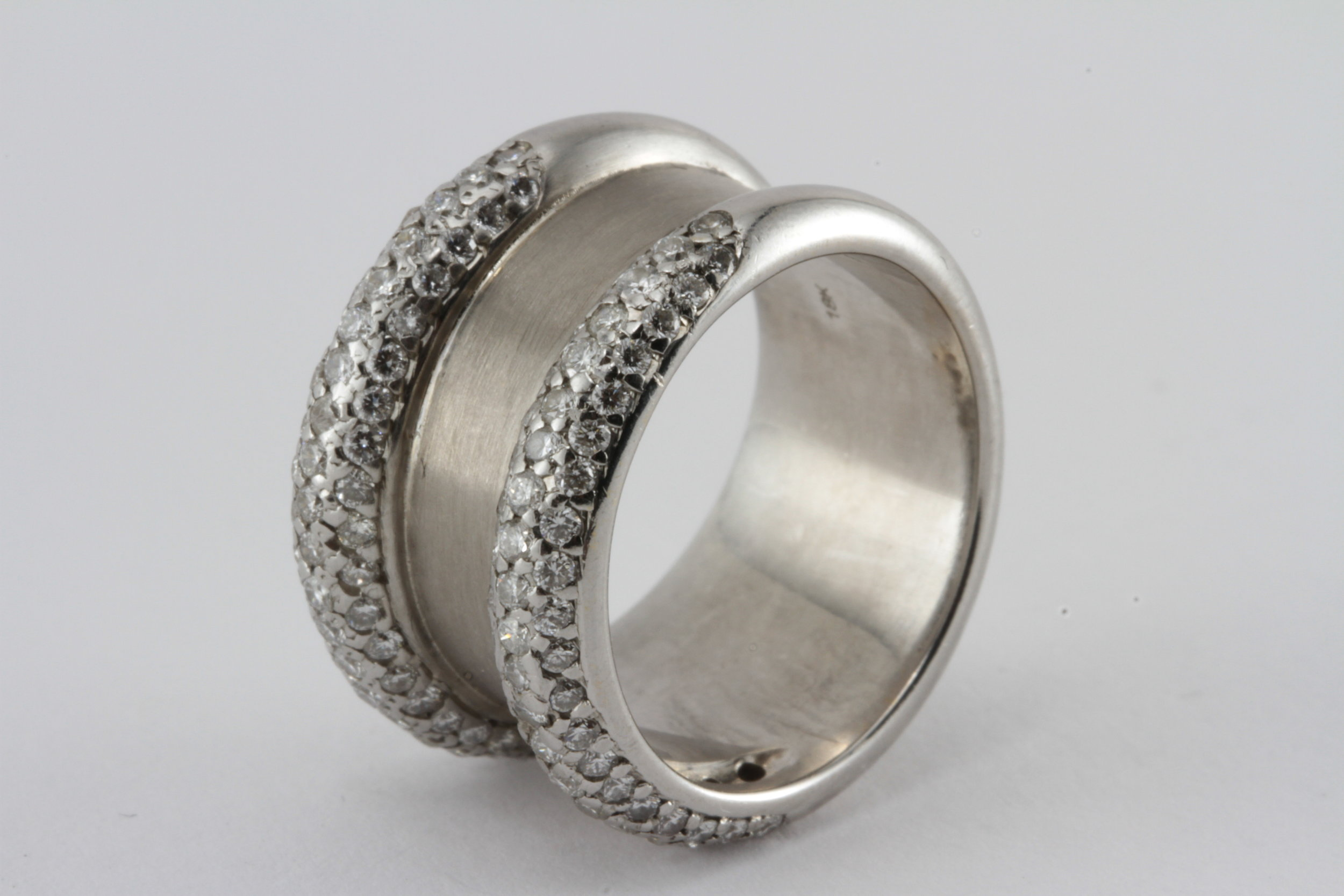 a contemporary 18k gold band with 2 rows of pave set diamond