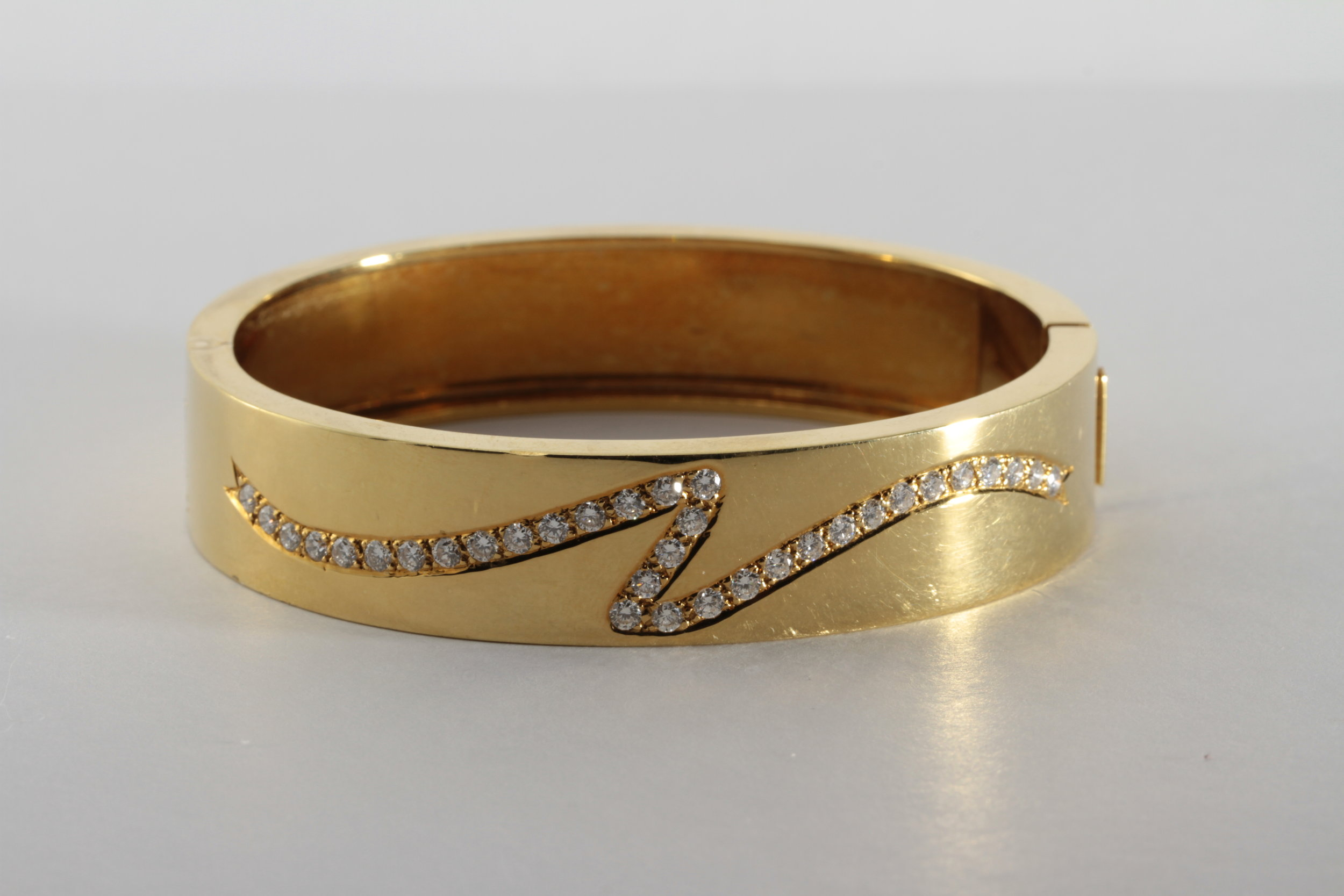 vintage 18k gold bangle with very clean diamonds