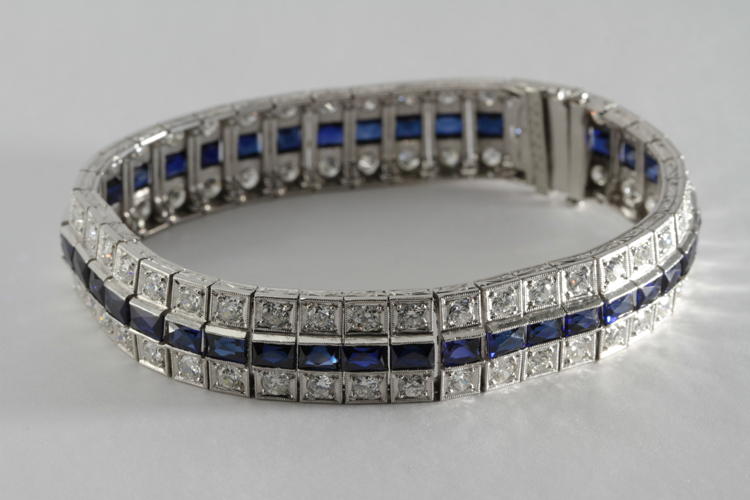 art deco french cut sapphire and 8 carats of diamond in platinum