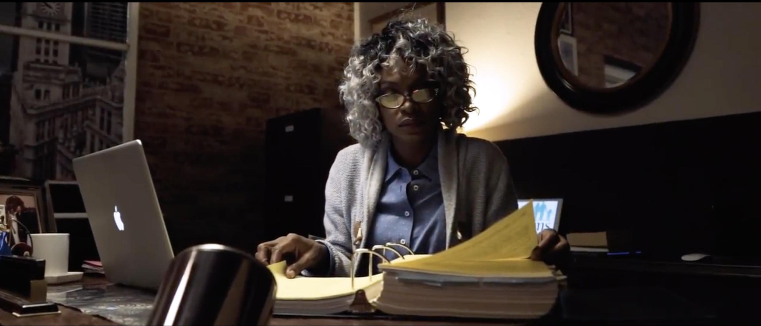 Lisa at Desk.png