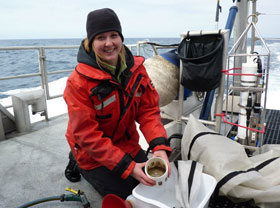 Andrea Dransfield holding krill samples while on research vessel, photo by Jamie Jahncke