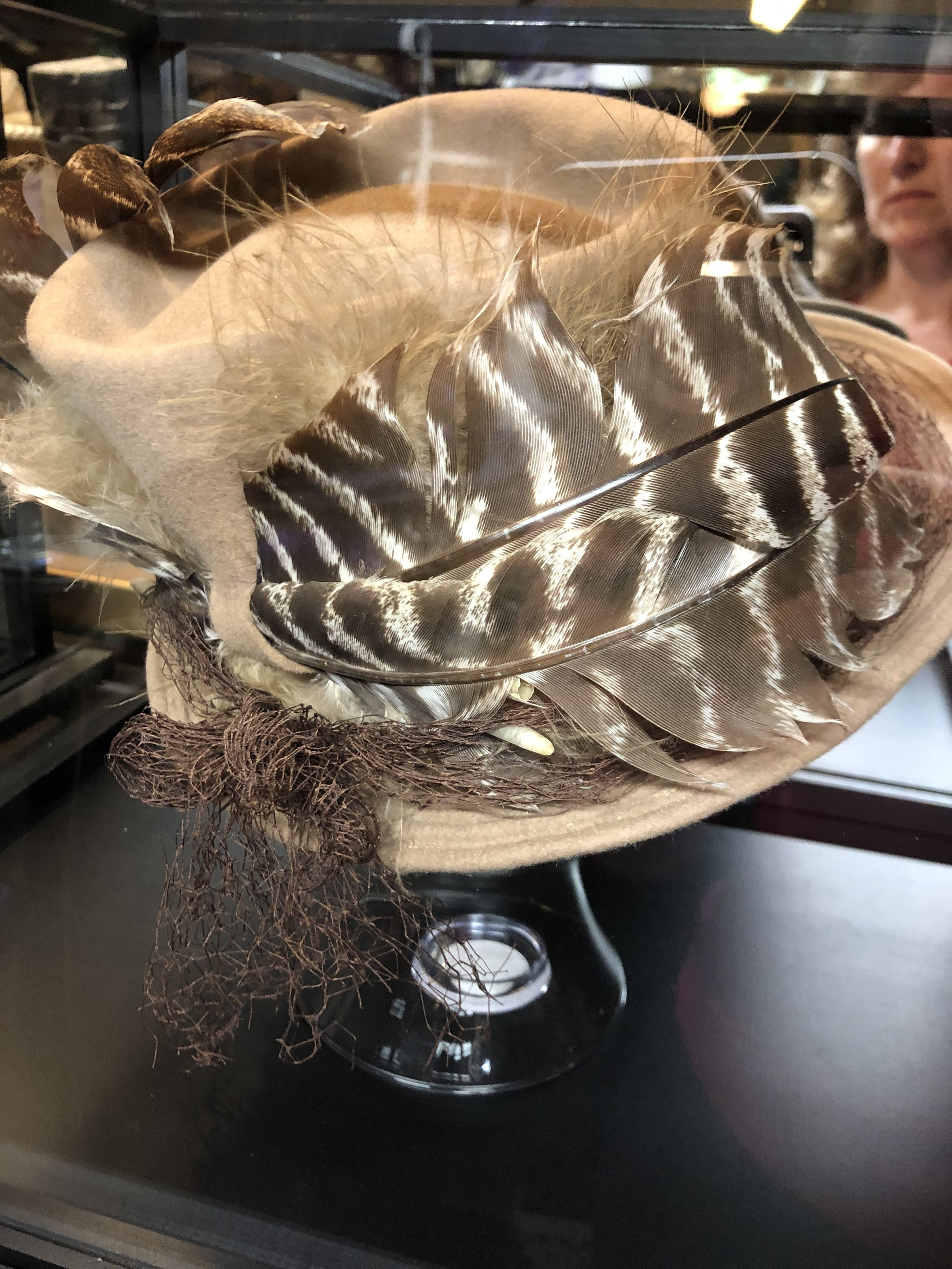 This Vogue Hat has a curled wild turkey feather.