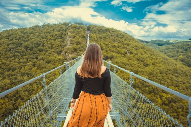 https://www.pexels.com/photo/woman-walking-on-bridge-1273443/