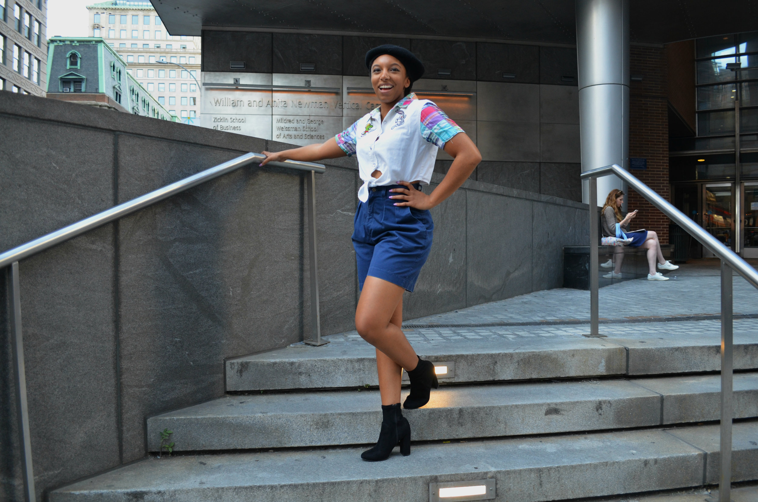 J'na in the Vintage Looney Tunes Button Up Crop Top and Vintage Navy Cotton Pleated Shorts.