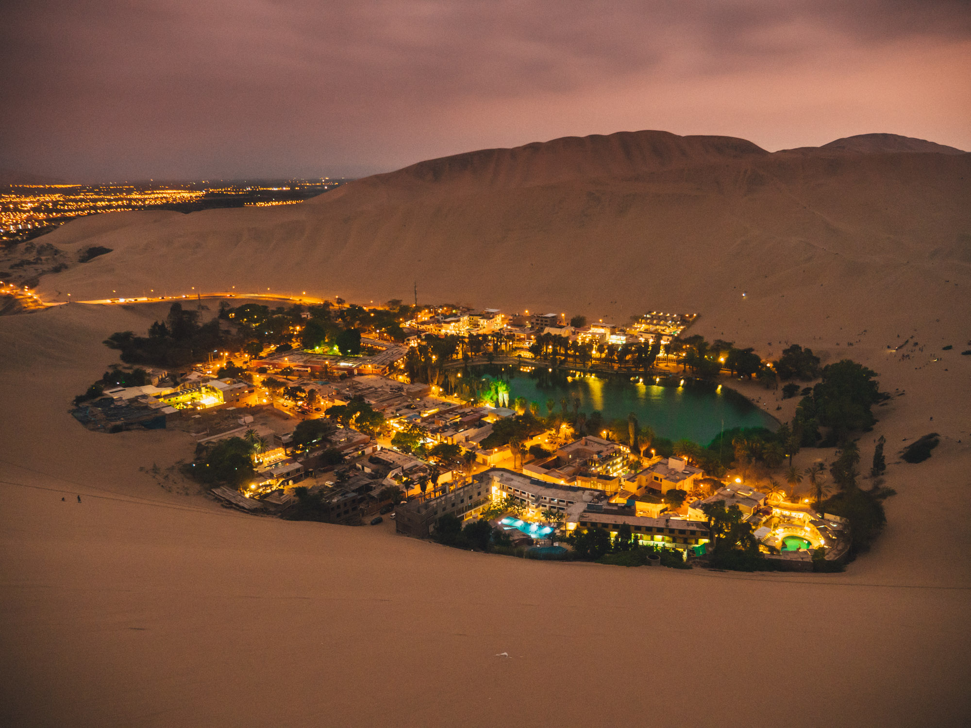 The oasis of Huacachina is little gem in the sand dune desert about 7 km from Ica, Peru. It has about 100 inhabitants, not counting the large amounts of tourists visiting this place. You can sign up for a ride in a buggy over sand dunes and go sand boarding.