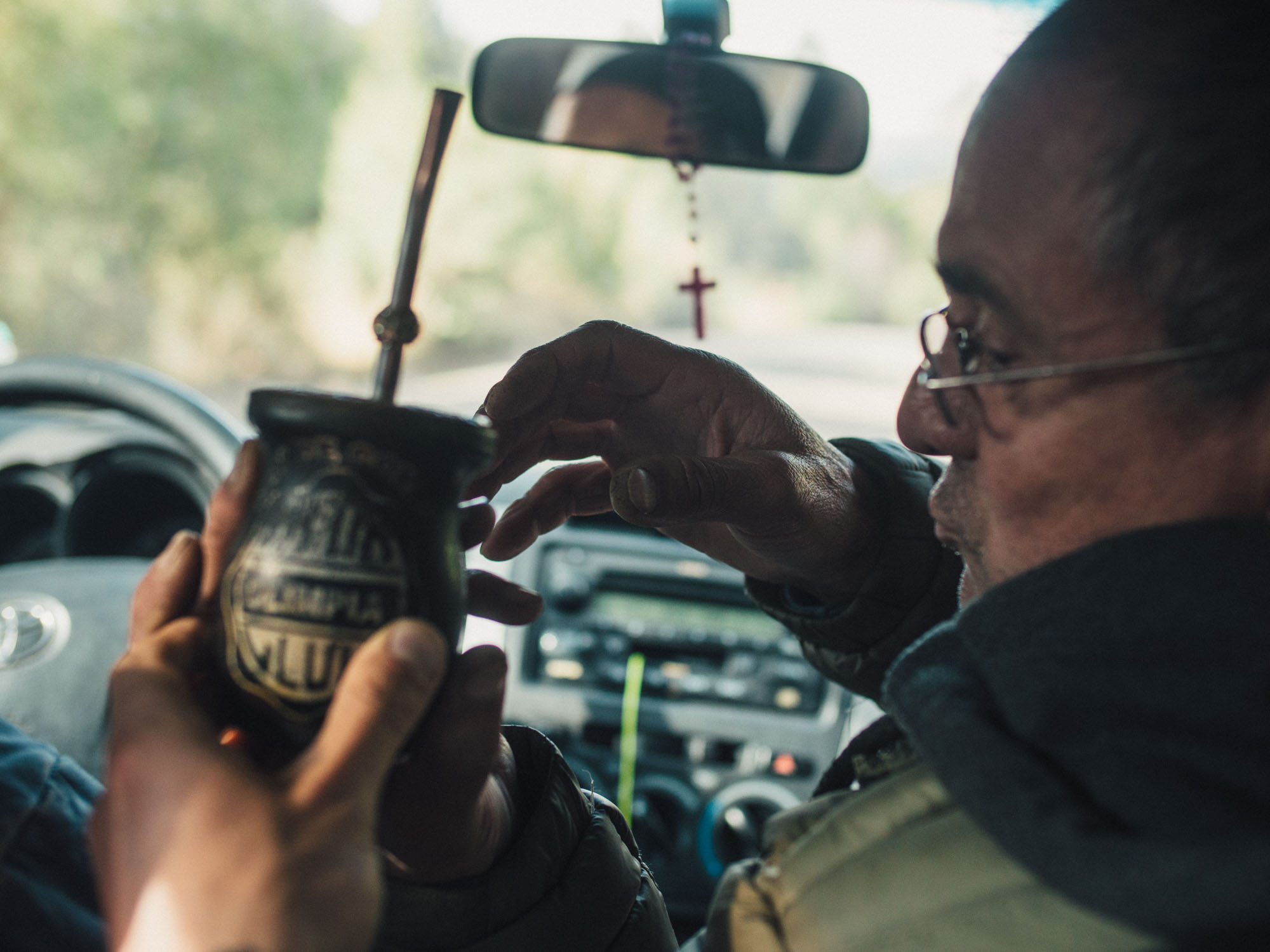 Warming up in a car with  mate,  a traditional Argentinian tea that gets shared around in a wooden cup.