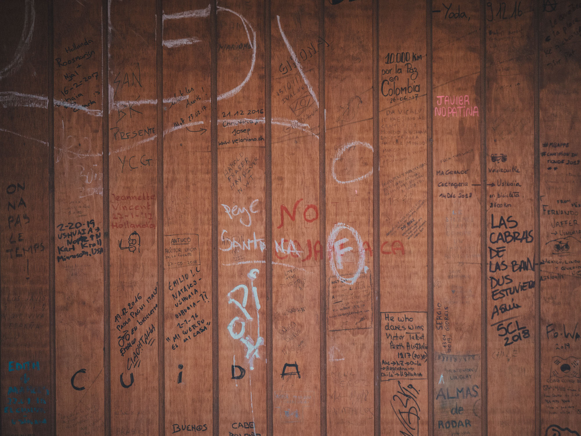 The markings from other travellers in a refugio along the road.