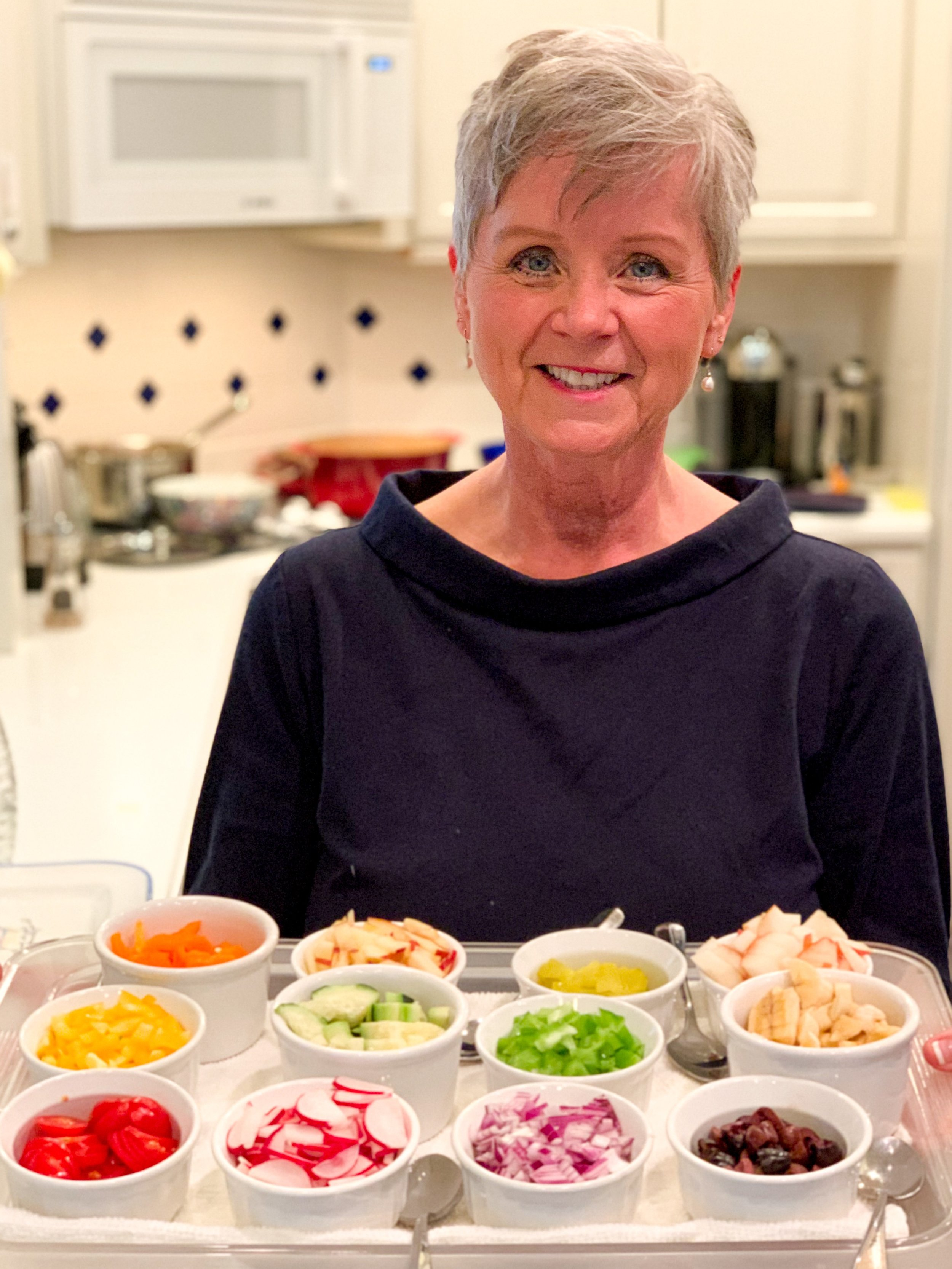 Auntie Linda brings our feast to the table