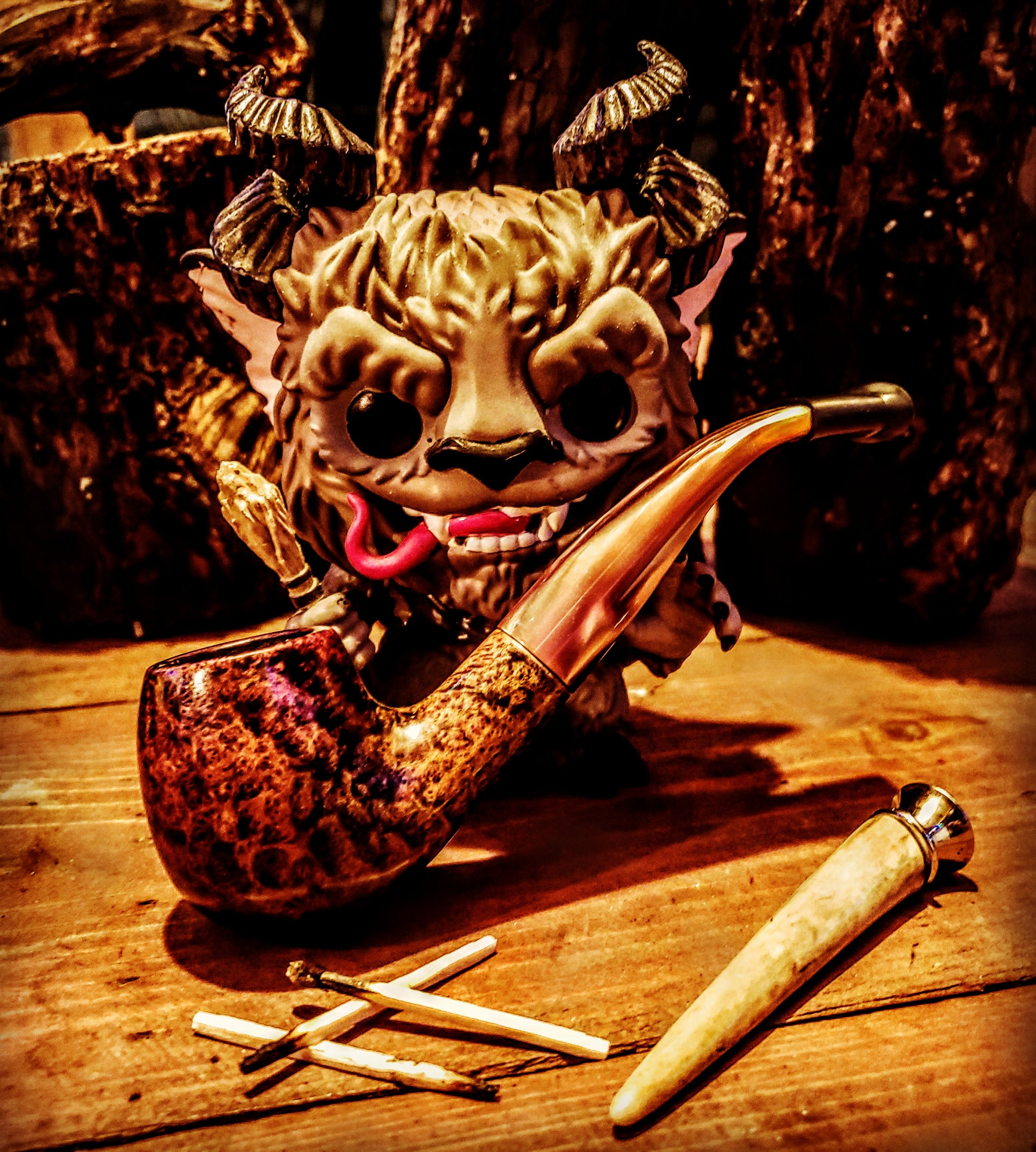 My little pop vinyl Krampus with my Doc K Briar pipe smoking some Davendoff Royalty