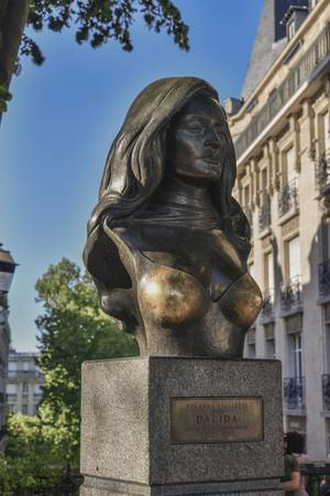 102537437-paris-france-may-8-2018-brass-bust-of-teh-famous-french-singer-dalida-in-montmartre-district-in-pari.jpg