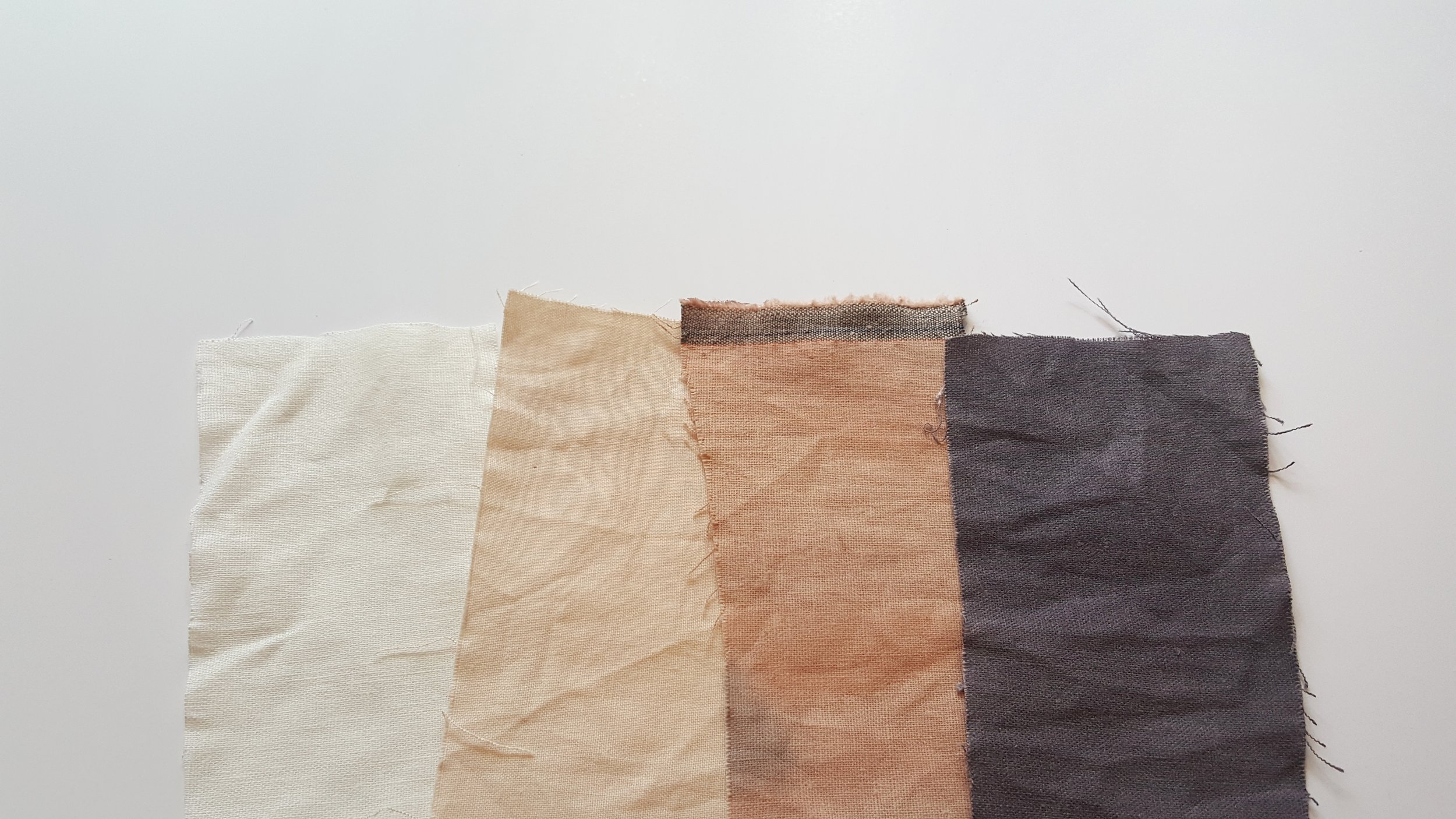 From left to right: 1. white cotton/ linen blend (no dye), 2. cotton/ linen blend with no mordant and avocado dye, 3. cotton/ linen blend with a soy mordant and an avocado dye, 4. cotton/ linen blend with a soy mordant, avocado dye and a dash of iron added to dye bath.