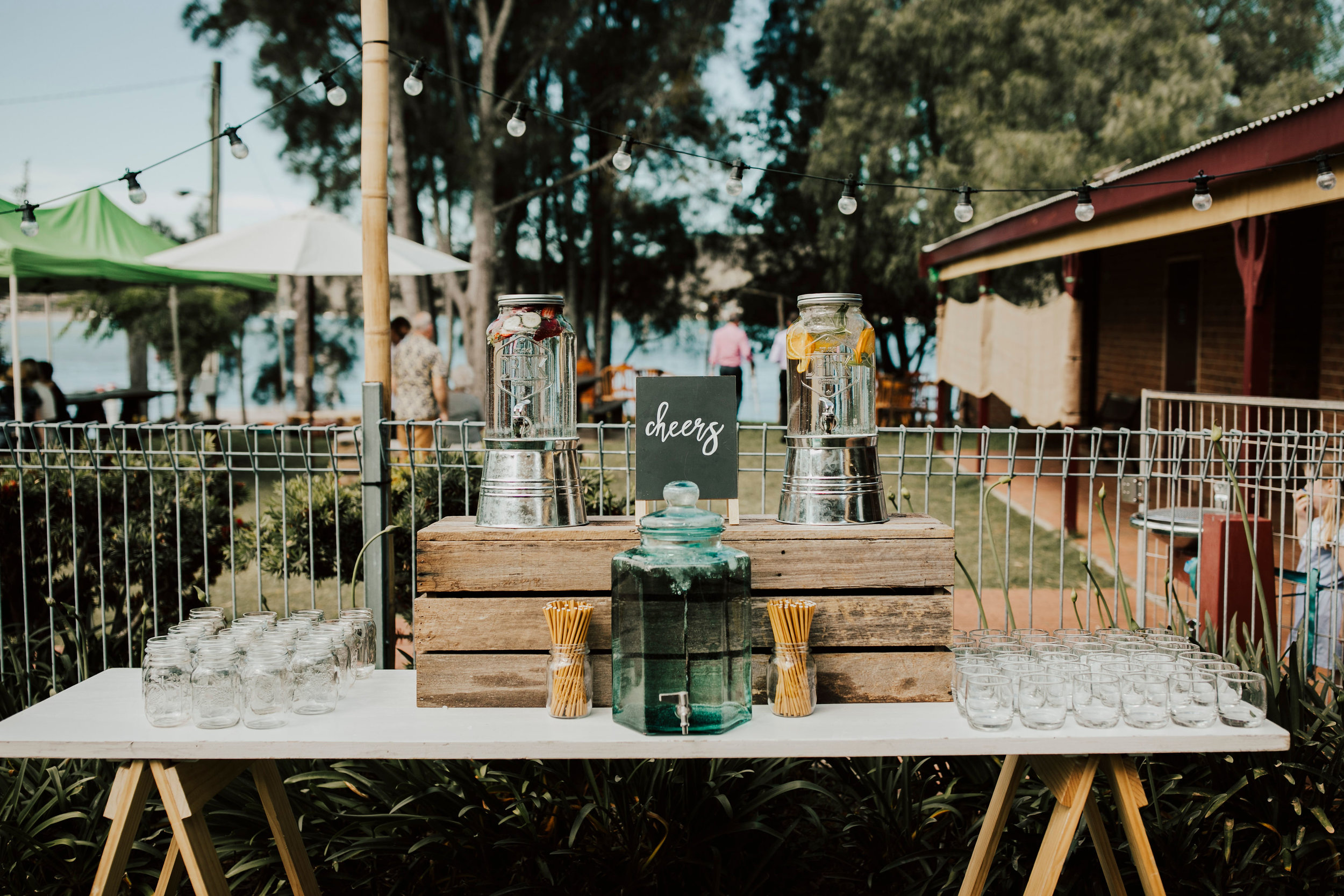 Hydration Station # $220 # Includes: trestle table, drink dispensers w/ fruit infused water, drinking jars, glassware, paper straws, bottled water, galvanised buckets, decor and signage.