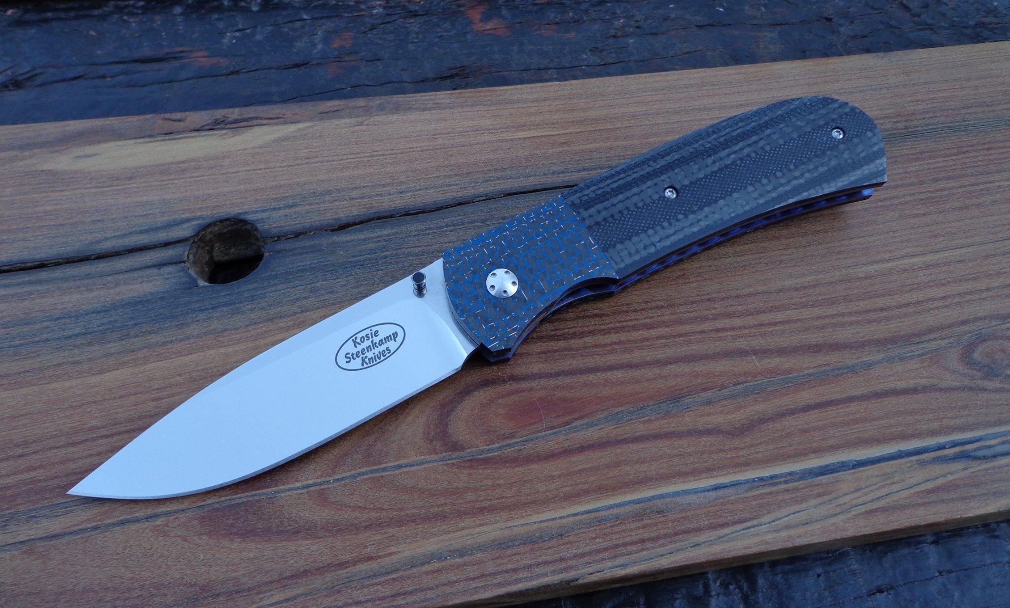 Knife: Sakson II. Blade: Böhler N690 Stainless Steel. Liners: Titanium, anodized blue. Handle scales: G10 + Carbon Fibre and Lightning Strike Carbon Fibre with anodized Titanium belt clip.