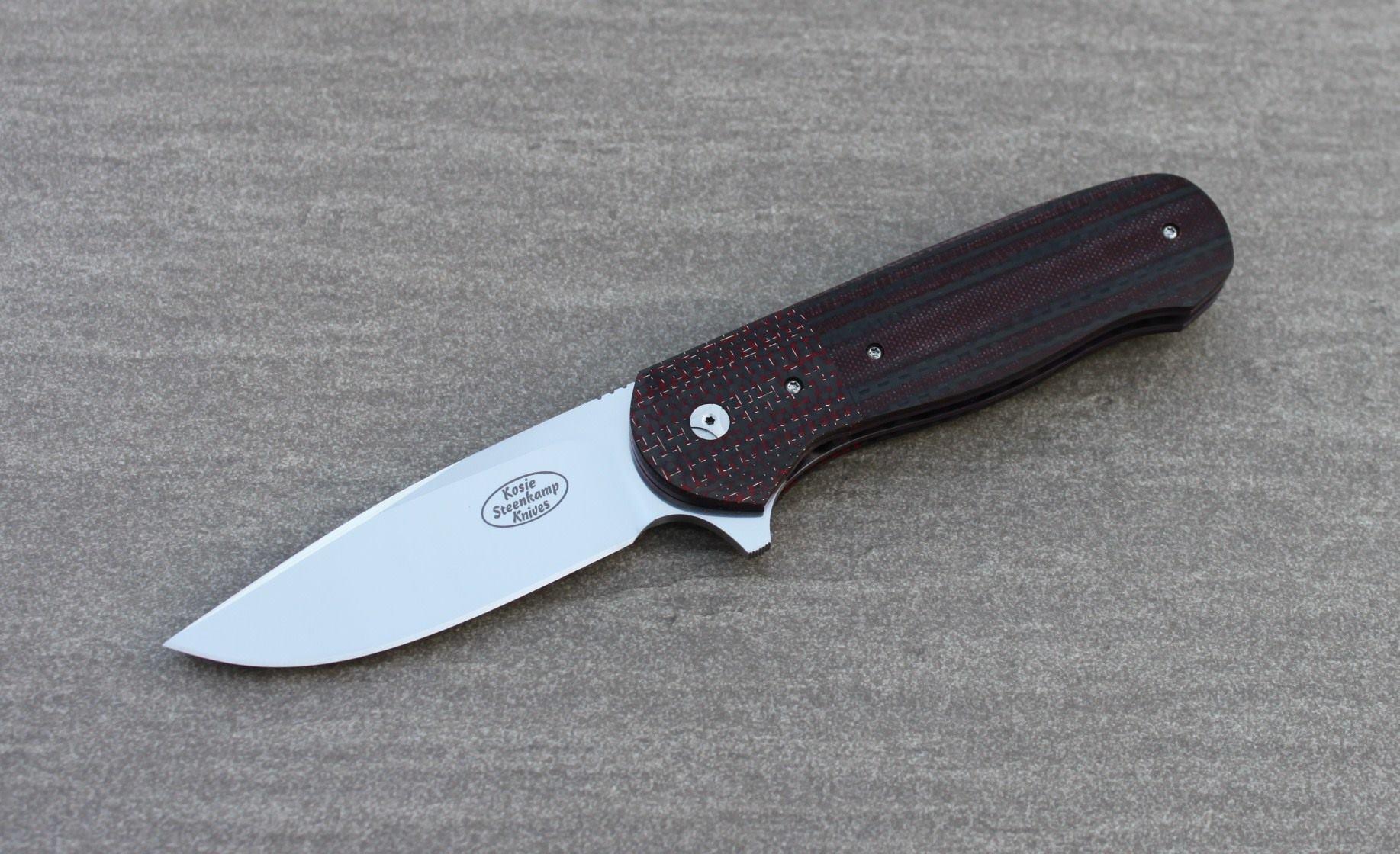 Knife: Vantage Flipper Liner Lock - IKBS. Böhler N690 Stainless Steel blade. Titanium liners with red LSCF + red and black G10 handle scales. Titanium belt clip.