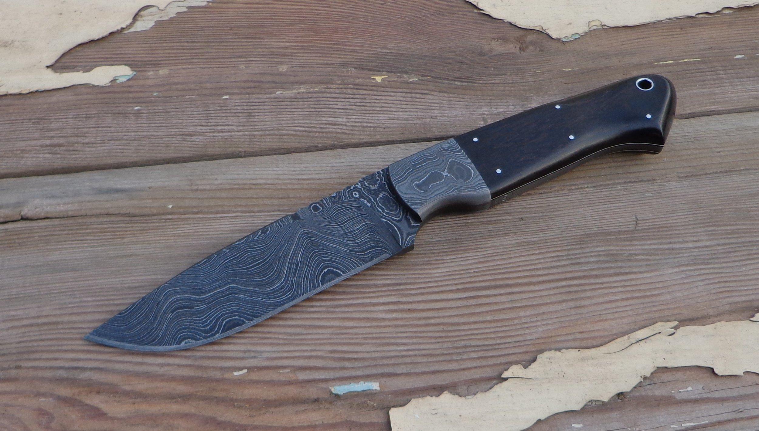 Cass Hunter. Alabama Damascus Steel blade and bolsters. African Blackwood handle slabs.