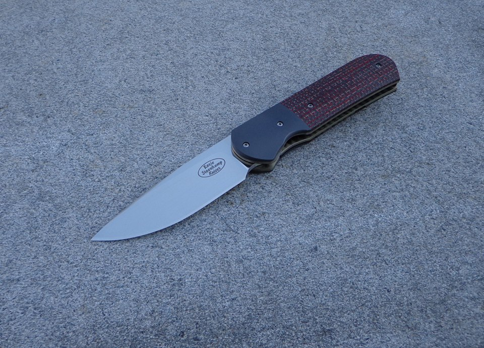 Knife: Samson Liner Lock. Blade: Böhler N690 Stainless Steel . Bolsters: Zirconium. Liners: Titanium, anodized golden. Handle scales: LS Carbon Fiber with anodized Titanium belt clip.